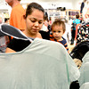 "0823HM5.jpg Holding her son Liam Trvizo (right), Maria Trvizo (left) looks at clothing during grand opening of the H&M store at Flatiron Crossing in Broomfield, Colorado August 23, 2012. BOULDER DAILY CAMERA/ Mark Leffingwell<br /> <br /> <br /> See video of shoppers at the new H&M store at  <a href=""http://www.dailycamera.com"">http://www.dailycamera.com</a>"