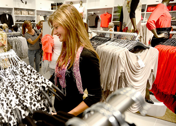 "0823HM4.jpg Sara Gates smiles as she browses clothing during grand opening of the H&M store at Flatiron Crossing in Broomfield, Colorado August 23, 2012. BOULDER DAILY CAMERA/ Mark Leffingwell<br /> <br /> <br /> See video of shoppers at the new H&M store at  <a href=""http://www.dailycamera.com"">http://www.dailycamera.com</a>"