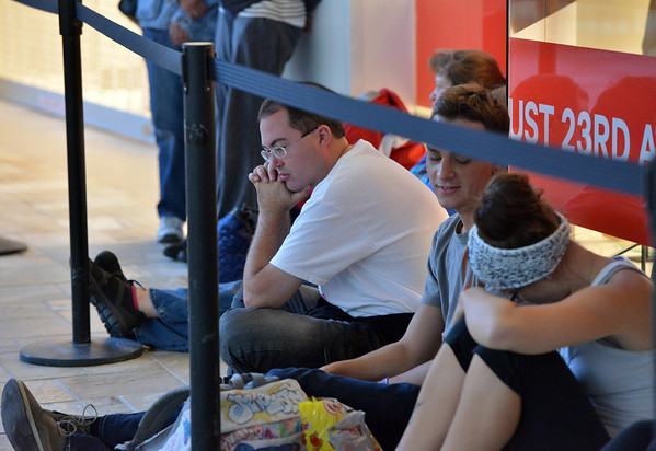 Chad Fogelberg waits in line for the opening of the new H&M store on Thursday at FlatIron Crossing mall.<br /> August 23, 2012<br /> staff photo/ David R. Jennings
