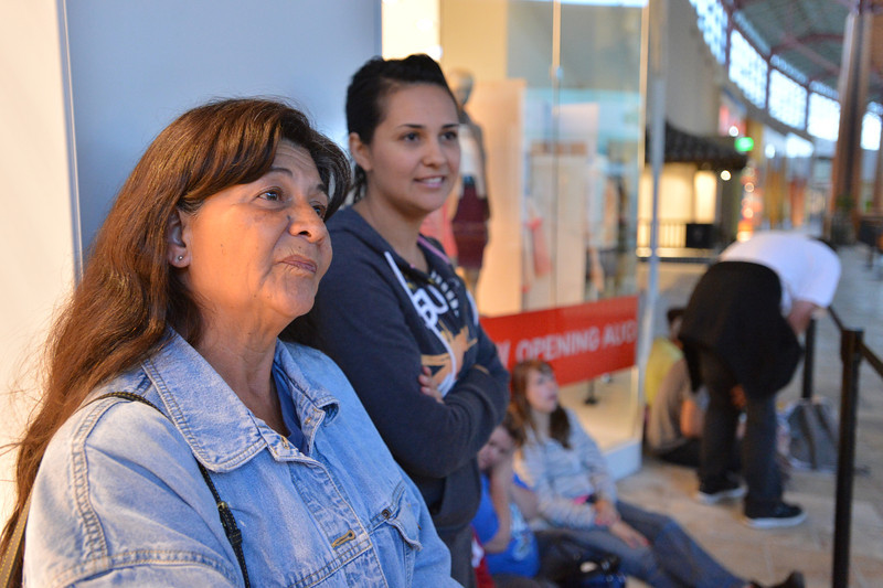 Gloria Herrera, left, and her daughter Michelle from Denver stand  first in line since 4:30 p.m. Wednesday for the opening of the new H&M store on Thursday at FlatIron Crossing mall.<br /> August 23, 2012<br /> staff photo/ David R. Jennings