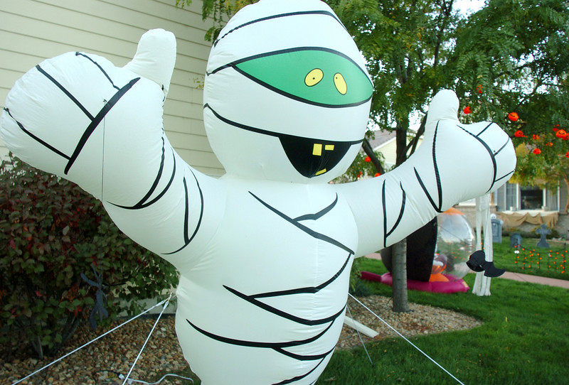 An inflatable mummy greets visitors for the Halloween displays in the 14300 neighborhood of Craftsman Way on Thursday<br /> <br /> October 21, 2010<br /> staff photo/David R. Jennings
