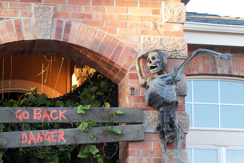 A skeleton on the wall warns visitors to the Halloween display at 4335 Lexi Circle on Thursday<br /> <br /> October 21, 2010<br /> staff photo/David R. Jennings