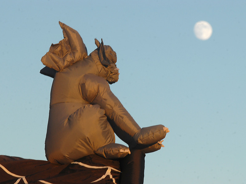 A gargoyle with the moon rising behind it at the 14341 Craftsman Way Halloween display on Thursday<br /> <br /> October 21, 2010<br /> staff photo/David R. Jennings