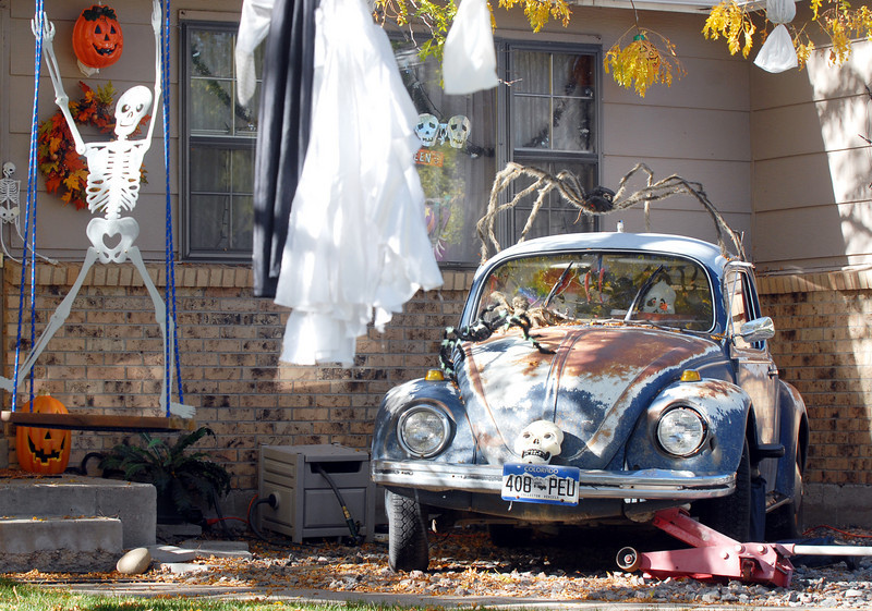 A Volkswagon with a spider on top surrounded by ghosts and skeletons for the Halloween display at 1385 Abilene Drive on Thursday<br /> <br /> October 21, 2010<br /> staff photo/David R. Jennings