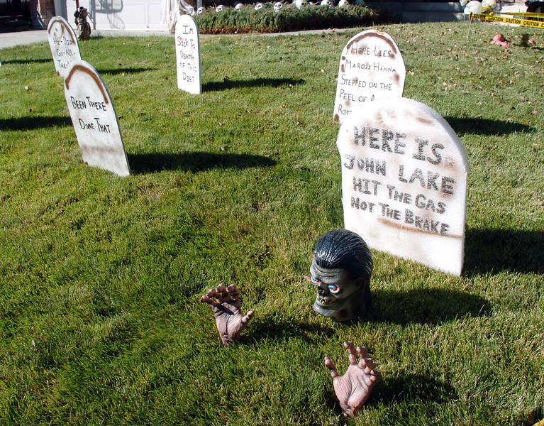 Tombstones with funny says on them in the Halloween display at 455 Golden Eagle Drive in Eagle Trace North on Thursday<br /> <br /> October 21, 2010<br /> staff photo/David R. Jennings