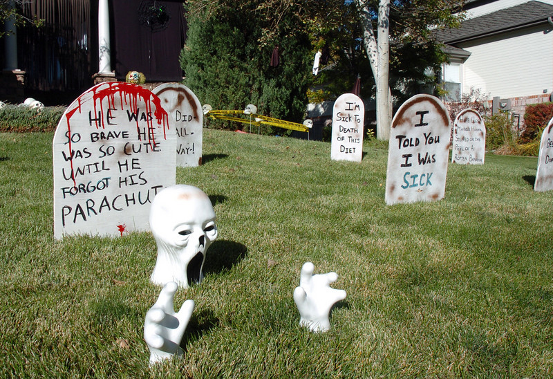 Tombstones with funny sayings on them in the Halloween display at 455 Golden Eagle Drive in Eagle Trace North on Thursday<br /> <br /> October 21, 2010<br /> staff photo/David R. Jennings