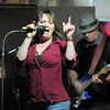 BE1125JAM03<br /> Rachel Jane Johnson sings with guitarist Bill Wright and Eric Rubin on drums during Wednesday's Hammer Jam at Hair of the Dog Tavern.  <br /> November 18, 2010<br /> staff photo/David R. Jennings