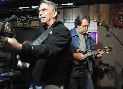 BE1125JAM02 Canyon  Creek band members John Good, left, guitar, and Rick Gottschalk, mandolin, play during Wednesday's Hammer Jam at Hair of the Dog Tavern.  The open mic night features individuals and bands who want to test their musical talents. November 18, 2010 staff photo/David R. Jennings