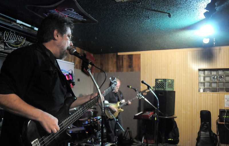 "BE1125JAM12<br /> Geno ""4 String"" Sirokman plays and sings with Mike ""Hammer"" Ryan and Greg ""Squiggy"" Steinman during Wednesday's Hammer Jam at Hair of the Dog Tavern.  The open mic night features individuals and bands who want to test their musical talents.<br /> November 18, 2010<br /> staff photo/David R. Jennings"