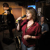 "BE1125JAM01<br /> Rachel Jane Johnson sings with Geno ""4 String"" Sirokman and Mike ""Hammer"" Ryan on drums during Wednesday's Hammer Jam at Hair of the Dog Tavern.  The open mic night features individuals and bands who want to test their musical talents.<br /> November 18, 2010<br /> staff photo/David R. Jennings"