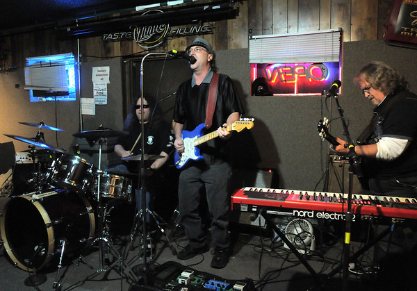 BE1125JAM09<br /> Eric Rubin on drums, Bill Wright on vocals and lead guitar with Greg Steinman play during Wednesday's Hammer Jam at Hair of the Dog Tavern.  <br /> November 18, 2010<br /> staff photo/David R. Jennings