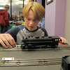 Matthew Roy, 14, works on a 1940's model train engine for the Hands-On Model Raillroads exhibit by Youth in Model Railroading on Saturday at the Mamie Doud Eisenhower Public LIbrary. <br /> October 8, 2011<br /> staff photo/ David R. Jennings