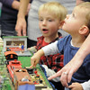 Sagan Bell, 2, right, watches what move when pressing a button while Michael Roba, 4 1/2, waits his turn at the controls during the Hands-On Model Railroads exhibit by Youth in Model Railroading on Saturday at the Mamie Doud Eisenhower Public LIbrary. <br /> October 8, 2011<br /> staff photo/ David R. Jennings
