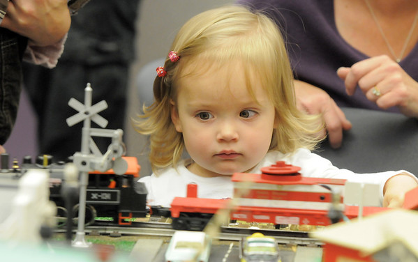 Morgan Connors, 2, watches a model train go by during the Hands-On Model Railroads exhibit by Youth in Model Railroading on Saturday at the Mamie Doud Eisenhower Public LIbrary. <br /> October 8, 2011<br /> staff photo/ David R. Jennings