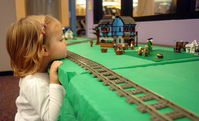 Morgan connors, 2, studies the Lego model train display during the Hands-On Model Raillroads exhibit by Youth in Model Railroading on Saturday at the Mamie Doud Eisenhower Public LIbrary. <br /> October 8, 2011<br /> staff photo/ David R. Jennings