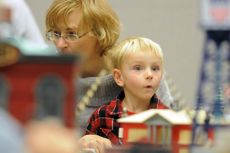 Michael Roba, 4 1/2, reacts to seeing an object move while pushing a button as he sits with his mother Iva during the Hands-On Model Railroads exhibit by Youth in Model Railroading on Saturday at the Mamie Doud Eisenhower Public LIbrary. <br /> October 8, 2011<br /> staff photo/ David R. Jennings