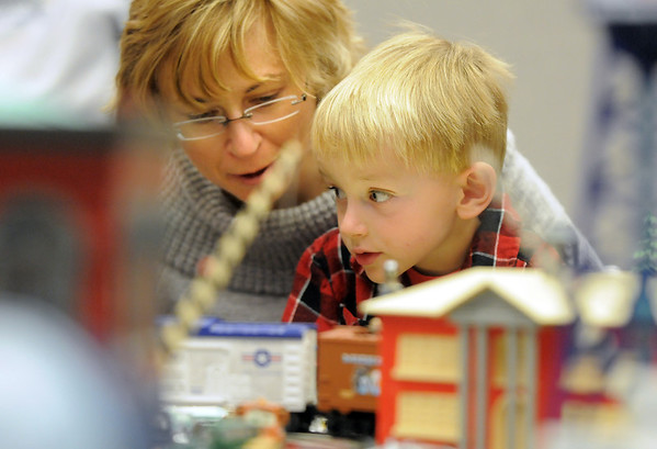 Michael Roba, 4 1/2, watches things move with his mother Iva during the Hands-On Model Railroads exhibit by Youth in Model Railroading on Saturday at the Mamie Doud Eisenhower Public LIbrary. <br /> October 8, 2011<br /> staff photo/ David R. Jennings