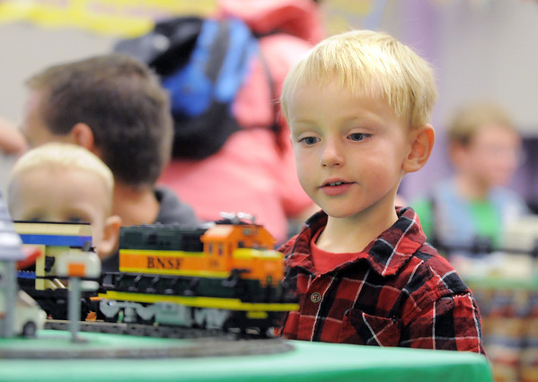 Michael Roba, 4 1/2, watches a Lego train move o the tracks during the Hands-On Model Railroads exhibit by Youth in Model Railroading on Saturday at the Mamie Doud Eisenhower Public LIbrary. <br /> October 8, 2011<br /> staff photo/ David R. Jennings