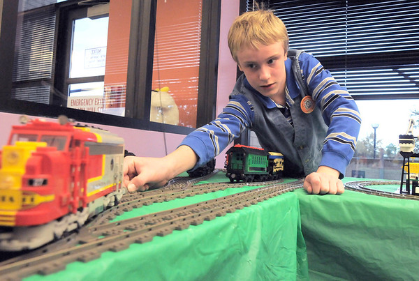 Grant Peterson, 12, helps set up the Lego train for the Hands-On Model Railroads exhibit by Youth in Model Railroading on Saturday at the Mamie Doud Eisenhower Public LIbrary. <br /> October 8, 2011<br /> staff photo/ David R. Jennings