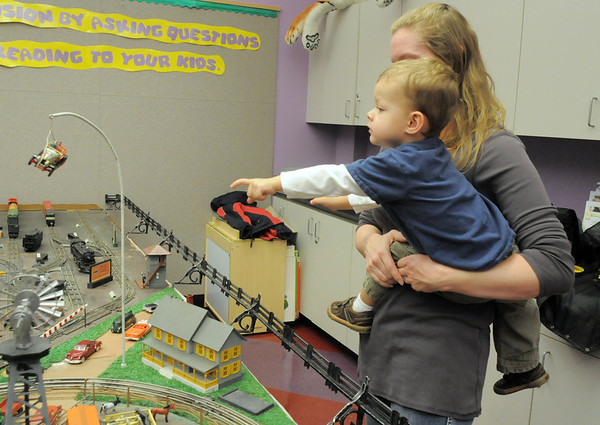 Sagan Bell, 2, reaches for the Chitty Chitty Bang Bang car while in the arms of his mother Adriane during the Hands-On Model Railroads exhibit by Youth in Model Railroading on Saturday at the Mamie Doud Eisenhower Public LIbrary. <br /> October 8, 2011<br /> staff photo/ David R. Jennings