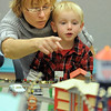 Iva Roba and her son Michael, 4 1/2, looka t the different things moving in the exhibit during the Hands-On Model Railroads  by Youth in Model Railroading on Saturday at the Mamie Doud Eisenhower Public LIbrary. <br /> October 8, 2011<br /> staff photo/ David R. Jennings