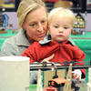 Julie Rieken and her daughter Ruth, 2, watch trains go by during the Hands-On Model Railroads exhibit by Youth in Model Railroading on Saturday at the Mamie Doud Eisenhower Public LIbrary. <br /> October 8, 2011<br /> staff photo/ David R. Jennings