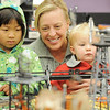 Julie Rieken, center,  with her daughters Maggie, 6, left, and Ruth, 2, watch cows be oaded onto a train car during the Hands-On Model Railroads exhibit by Youth in Model Railroading on Saturday at the Mamie Doud Eisenhower Public LIbrary. <br /> October 8, 2011<br /> staff photo/ David R. Jennings