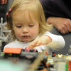 Morgan Connors, 2, watches a model train go by during the Hands-On Model Railroads exhibit by Youth in Model Railroading on Saturday at the Mamie Doud Eisenhower Public LIbrary. <br /> <br /> October 8, 2011<br /> staff photo/ David R. Jennings