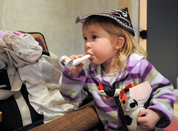 Madison Skinner, 3, tries to blow her noise maker during the Happy Noon Year celebration after the performance by Lazer Vaudeville on Friday at the Broomfield Auditorium.<br /> December 31, 2010<br /> staff photo/David R. Jennings