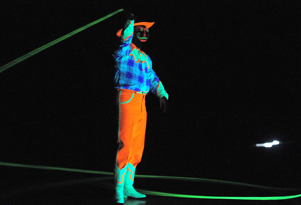 Lazer Vaudeville performer Carter Brown twirls a rope while being lit by ultraviolet light  during the Happy Noon Year celebration on Friday at the Broomfield Auditorium.<br /> December 31, 2010<br /> staff photo/David R. Jennings