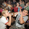 Amy Bowers, 7, left, blows a noise maker at her brother Kevin, 9, for the Happy Noon Year celebration after the performance by Lazer Vaudeville on Friday at the Broomfield Auditorium.<br /> December 31, 2010<br /> staff photo/David R. Jennings