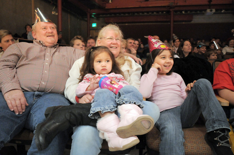 John and Donna Norman watch the Lazer Vaudeville performance with their grand children Rosie Bowles, 2, and Melita Bowles, 8, during the Happy Noon Year celebration at the Broomfield Auditorium on Friday.<br /> December 31, 2010<br /> staff photo/David R. Jennings