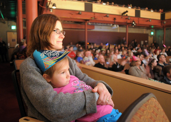 Rachel Guerrera and her daughter Cecilia, 4, watch the Lazer Vaudeville  performance during the Happy Noon Year celebration on Friday at the Broomfield Auditorium.<br /> December 31, 2010<br /> staff photo/David R. Jennings