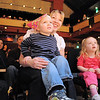 Caleb Wakefield, 8, left, Cody Tabor, 3, and his mother Amy and Kinley Hollonds, 3, watch the performance of clown Jim Jackson during the Happy Noon Year celebration at the Broomfield Auditorium on Saturday.<br /> December 31, 2011<br /> staff photo/ David R. Jennings