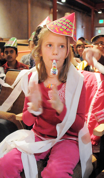 """Rachel Wakefield, 8, blows a noisemaker during the Happy Noon Year celebration at the Broomfield Auditorium on Saturday. More then 300 children and their relatives watched Jim Jackson perform at the Mamie Doud Eisenhower Public Library show.<br /> <br /> More photos please see  <a href=""""http://www.broomfieldenterprise.com"""">http://www.broomfieldenterprise.com</a><br /> December 31, 2011<br /> staff photo/ David R. Jennings"""