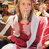 "Rachel Wakefield, 8, blows a noisemaker during the Happy Noon Year celebration at the Broomfield Auditorium on Saturday. More then 300 children and their relatives watched Jim Jackson perform at the Mamie Doud Eisenhower Public Library show.<br /> <br /> More photos please see  <a href=""http://www.broomfieldenterprise.com"">http://www.broomfieldenterprise.com</a><br /> December 31, 2011<br /> staff photo/ David R. Jennings"