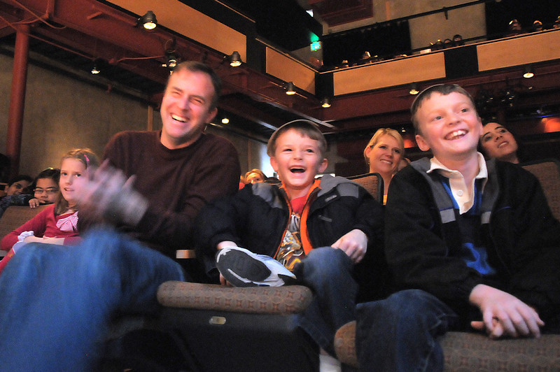 Mark Wakefield, left, laughs with his sons Micah, 6, and Caleb, 8, at the antics of clown Jim Jackson during the Happy Noon Year celebration at the Broomfield Auditorium on Saturday. <br /> <br /> <br /> December 31, 2011<br /> staff photo/ David R. Jennings