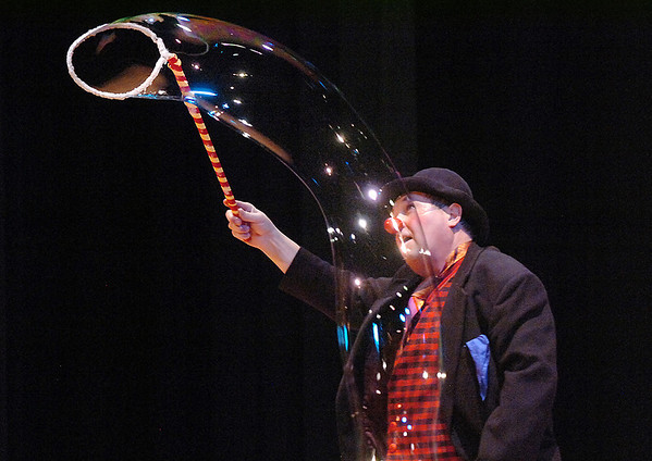 "Clown Jim Jackson makes a giant long bubble during his performance at the Happy Noon Year celebration at the Broomfield Auditorium on Saturday. <br /> <br /> More photos please see  <a href=""http://www.broomfieldenterprise.com"">http://www.broomfieldenterprise.com</a><br /> December 31, 2011<br /> staff photo/ David R. Jennings"