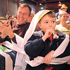 "Micah Wakefield, 6, center, blows his noisemaker while covered in toilet paper confetti with his father Mark, left, during the Happy Noon Year celebration at the Broomfield Auditorium on Saturday. <br /> More photos please see  <a href=""http://www.broomfieldenterprise.com"">http://www.broomfieldenterprise.com</a><br /> December 31, 2011<br /> staff photo/ David R. Jennings"