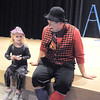 Ruby Clark, 4, left, chats with clown Jim Jackson after the Happy Noon Year celebration at the Broomfield Auditorium on Saturday. <br /> <br /> December 31, 2011<br /> staff photo/ David R. Jennings