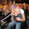 "Amy Tabor and her son Cody, 3, blow noisemakers to celebrate the new year during the Happy Noon Year celebration at the Broomfield Auditorium on Saturday. More then 300 children and their relatives watched Jim Jackson perform at the Mamie Doud Eisenhower Public Library show.<br /> <br /> More photos please see  <a href=""http://www.broomfieldenterprise.com"">http://www.broomfieldenterprise.com</a><br /> December 31, 2011<br /> staff photo/ David R. Jennings"