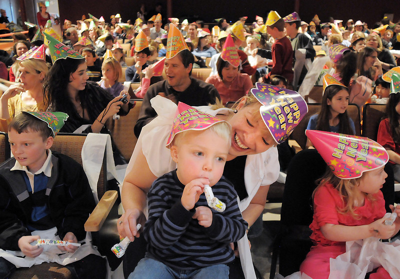 Amy Tabor and her son Cody, 3, celebrate after the countdown to noon at the Happy Noon Year celebration at the Broomfield Auditorium on Saturday. <br /> <br /> <br /> December 31, 2011<br /> staff photo/ David R. Jennings