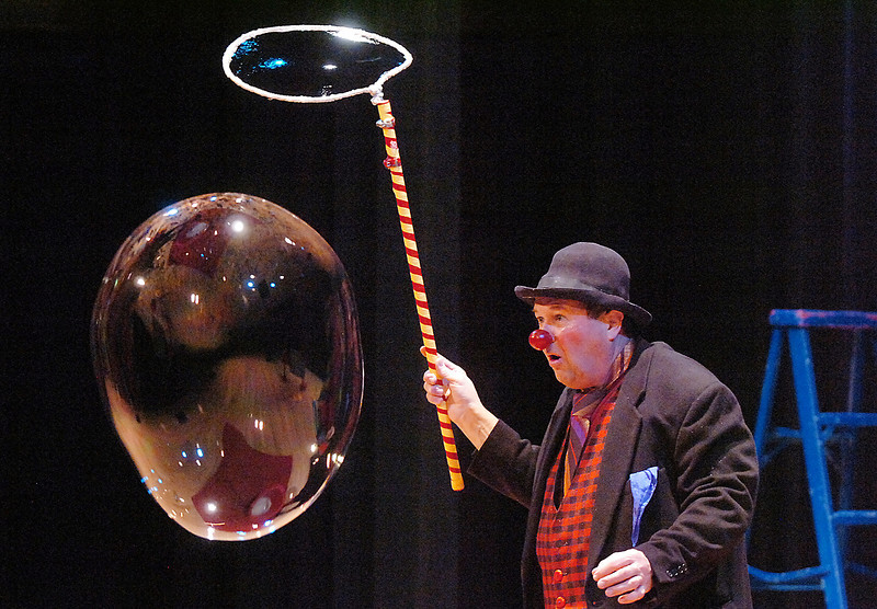 Clown Jim Jackson looks at a giant bubble during his performance at the Happy Noon Year celebration at the Broomfield Auditorium on Saturday. <br /> <br /> December 31, 2011<br /> staff photo/ David R. Jennings