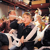 Micah Wakefield, 6, center, blows his noisemaker while celebrating the new year with his siblings Rachel, 8, left, Caleb 8, right, and their father Mark, after the countdown at the Happy Noon Year on Saturday at the Broomfield Auditorium.<br /> December 31, 2011<br /> staff photo/ David R. Jennings