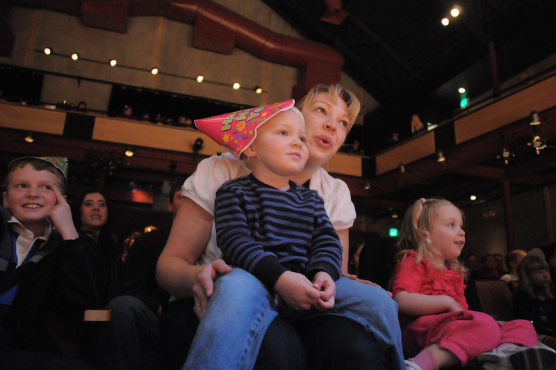 Amy Tabor and her son Cody, 3, watch the antics of clown Jim Jackson at the Happy Noon Year celebration at the Broomfield Auditorium on Saturday. <br /> <br /> <br /> December 31, 2011<br /> staff photo/ David R. Jennings