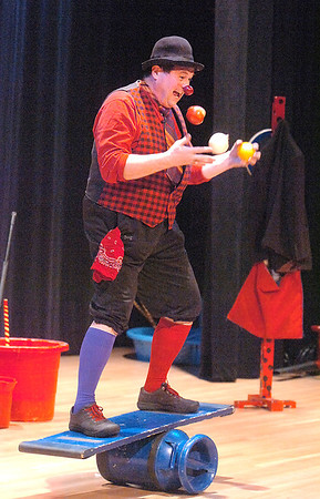 """Jim Jackson juggles fruit and vegetables while balancing on a plank during his performance for the Happy Noon Year celebration at the Broomfield Auditorium on Saturday. <br /> <br /> More photos please see  <a href=""""http://www.broomfieldenterprise.com"""">http://www.broomfieldenterprise.com</a><br /> December 31, 2011<br /> staff photo/ David R. Jennings"""
