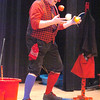 "Jim Jackson juggles fruit and vegetables while balancing on a plank during his performance for the Happy Noon Year celebration at the Broomfield Auditorium on Saturday. <br /> <br /> More photos please see  <a href=""http://www.broomfieldenterprise.com"">http://www.broomfieldenterprise.com</a><br /> December 31, 2011<br /> staff photo/ David R. Jennings"