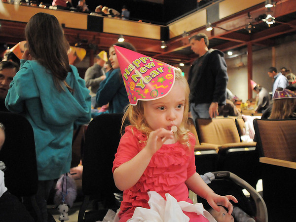 Kinley Hollonds, 3, eats candy after the Happy Noon Year celebration at the Broomfield Auditorium on Saturday. <br /> <br /> December 31, 2011<br /> staff photo/ David R. Jennings