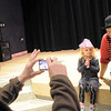 Jim Clark, left, takes a picture of his grand daughter Ruby Clark, 4, posing with clown Jim Jackson after  the Happy Noon Year celebration at the Broomfield Auditorium on Saturday. <br /> <br /> December 31, 2011<br /> staff photo/ David R. Jennings