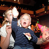 "Amy Tabor and her son Cody, 3,  cheer as the clock counts down to noon during the Happy Noon Year celebration at the Broomfield Auditorium on Saturday. More then 300 children and their relatives watched Jim Jackson perform at the Mamie Doud Eisenhower Public Library show.<br /> <br /> More photos please see  <a href=""http://www.broomfieldenterprise.com"">http://www.broomfieldenterprise.com</a><br /> December 31, 2011<br /> staff photo/ David R. Jennings"